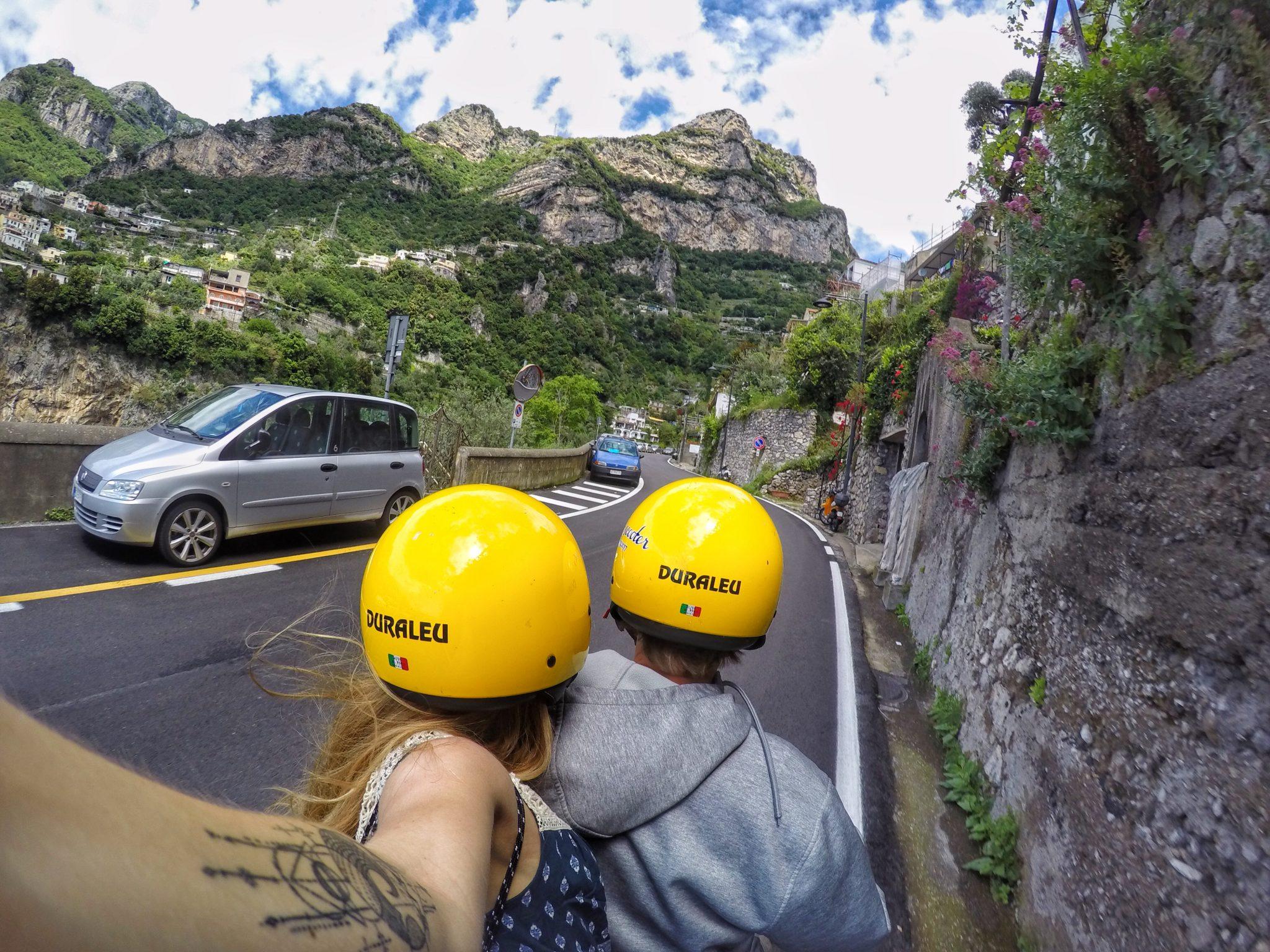 riding scooter amalfi coast, positano, italy